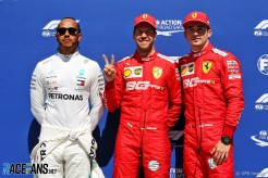 The Top Three Qualifiers : Second Place Lewis Hamilton (Mercedes AMG F1 Team), Pole Position Sebastian Vettel (Scuderia Ferrari) and Third Place Charles Leclerc (Scuderia Ferrari)