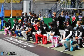 Formula 1 drivers take a knee